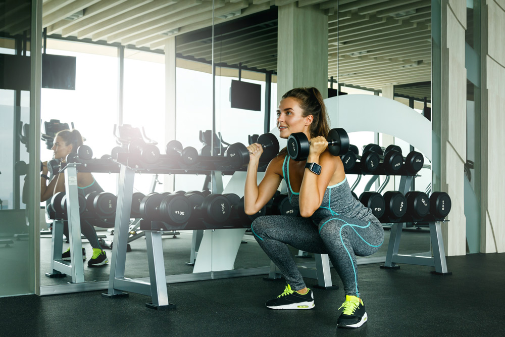 Adding dumbbell weights to squats