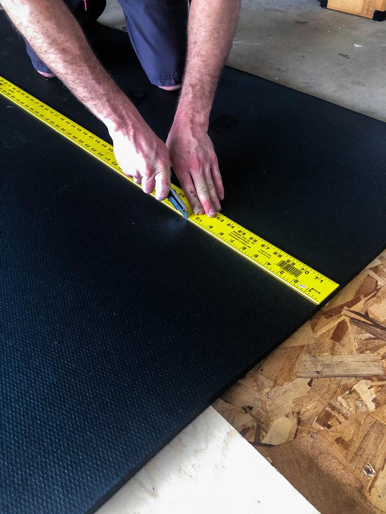 Cutting a fitness mat with a box cutter