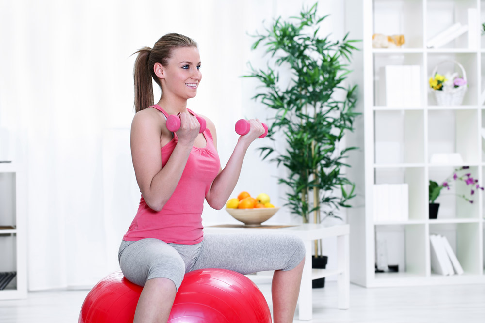 Squat to fitness ball and stand exercise