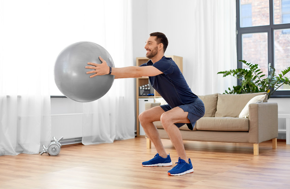 Exercise ball squat hold with a twist