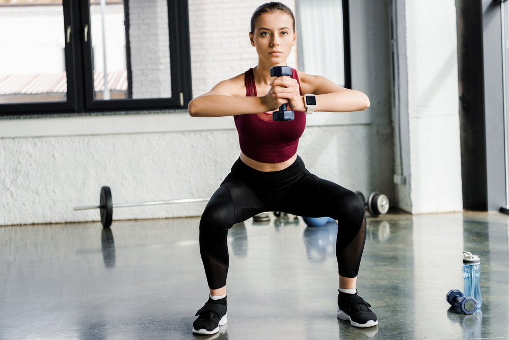 performing a dumbbell goblet squat leg exercise
