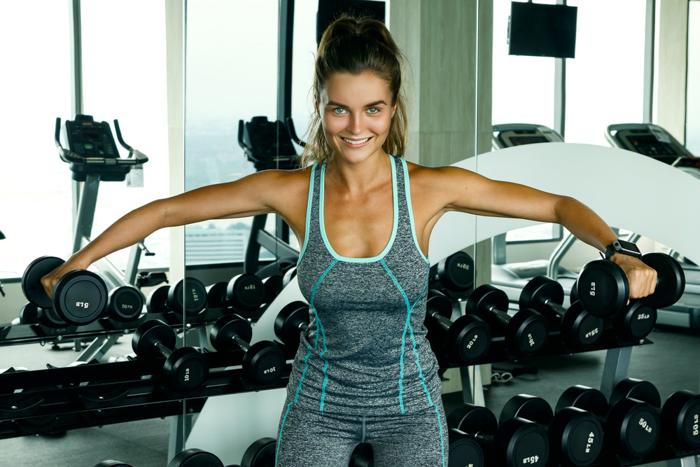 dumbbell lateral raise that can be performed in a home gym