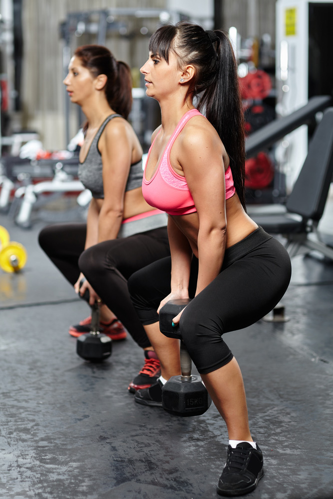 dumbbell sumo squats for a home leg workout