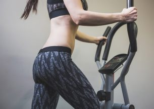 Woman Working Out On A Folding Elliptical Machine