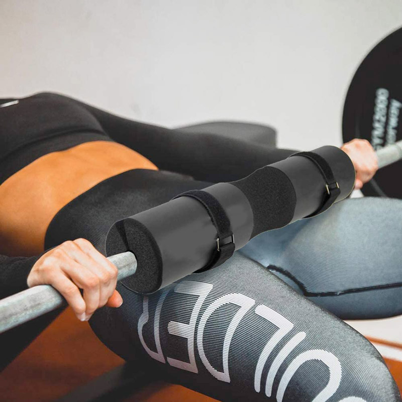 woman doing hip thrusters with a barbell pad on her thighs
