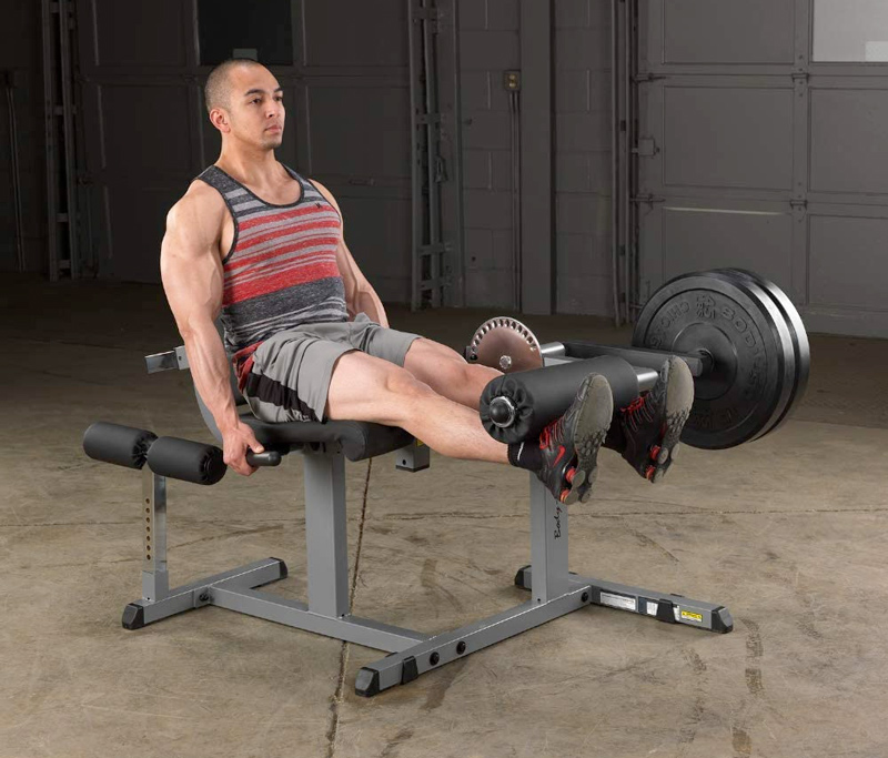 man performing a leg curl and extension exercise