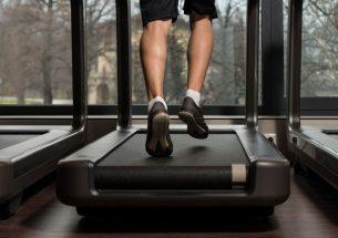 Man Running On A Manual Motorless Treadmill