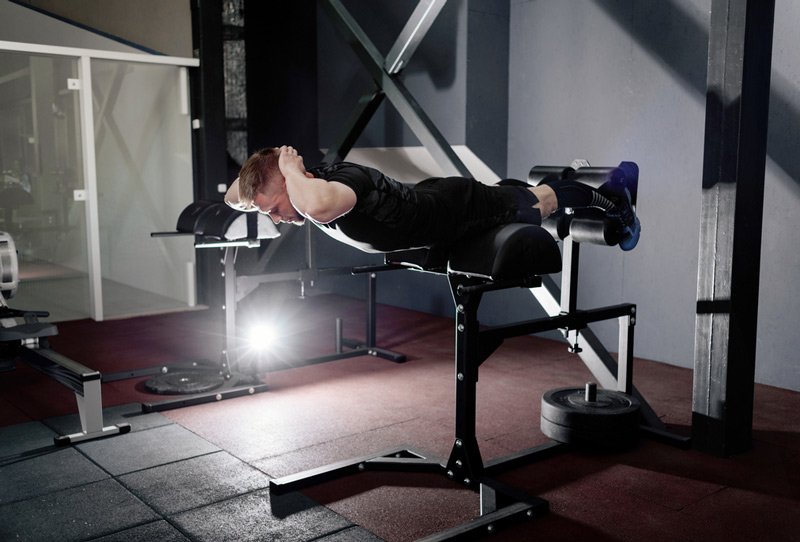 working out on a reverse hyper extension machine