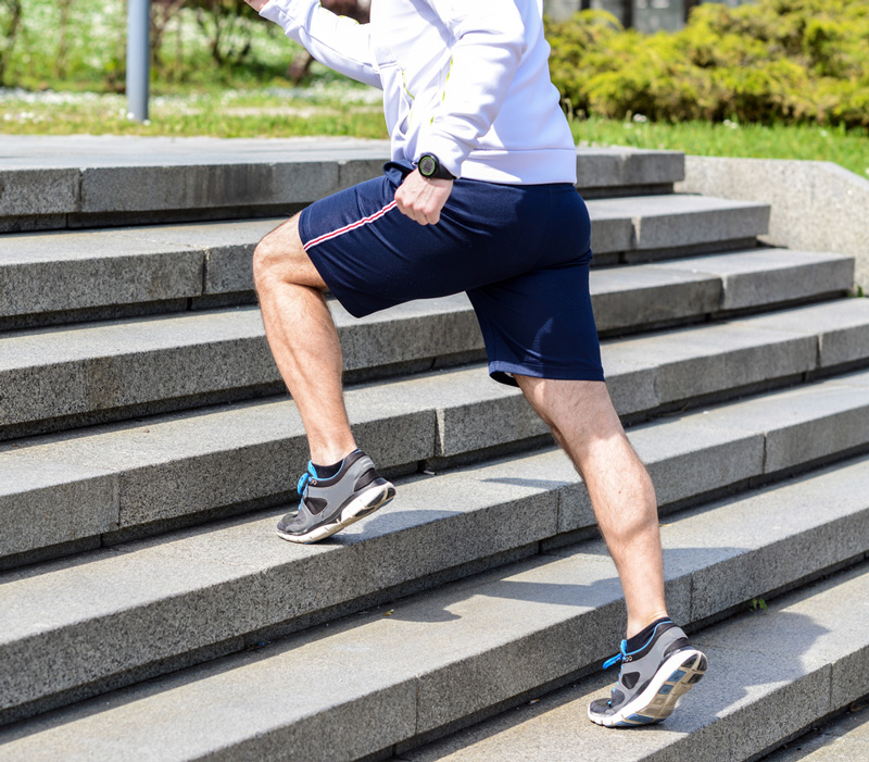 running up stairs for a calf workout in place of machines