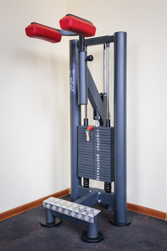 working out on a standing calf raise machine