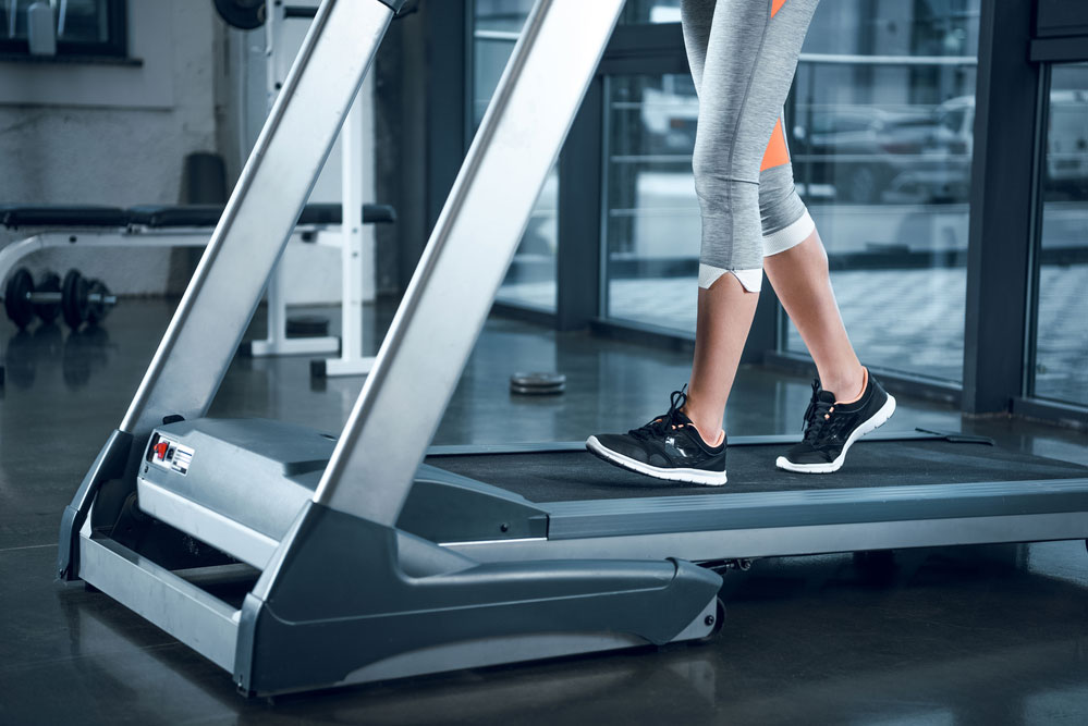 doing a hiit workout on a manual treadmill