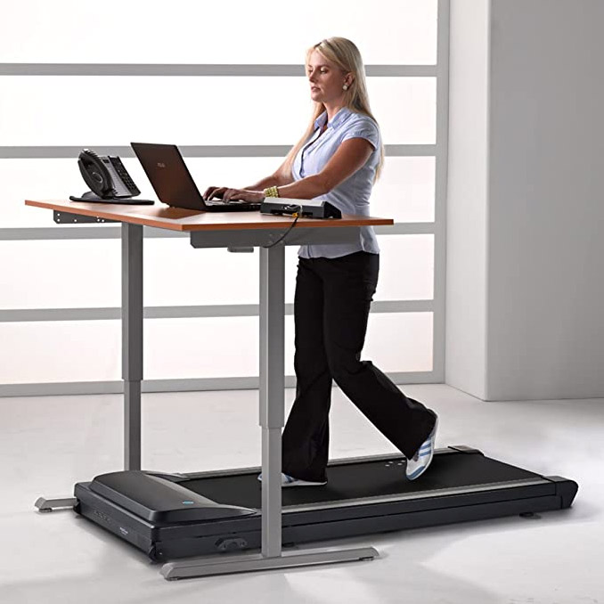 walking while working on a standing desk treadmill